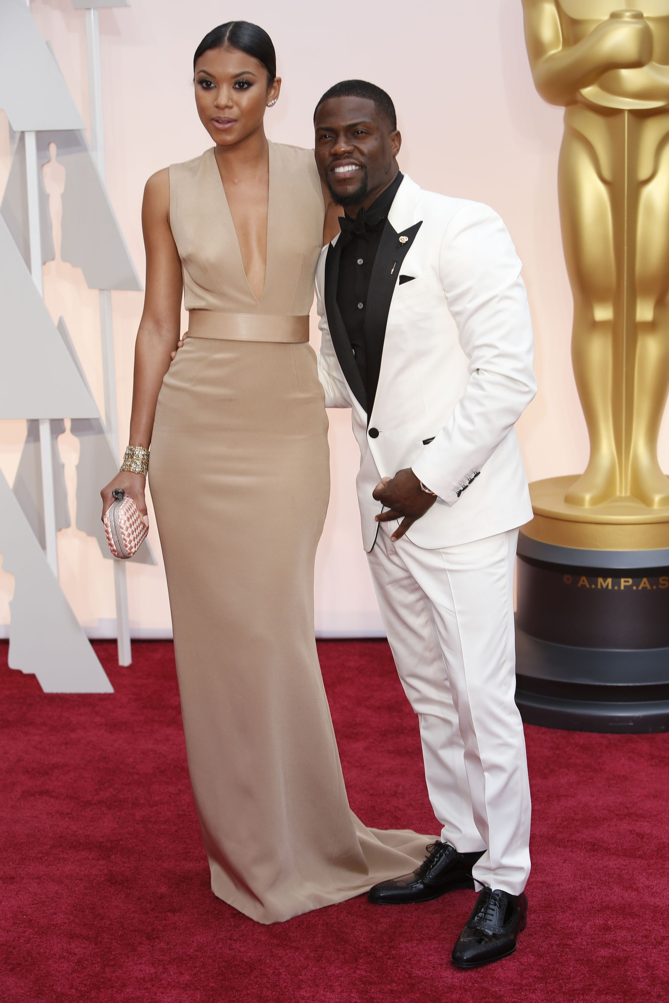 Oscar 2015 red carpet Kevin Hart and Eniko Parrish
