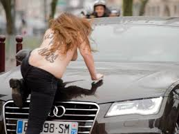 Topless protester at DSK trial 2