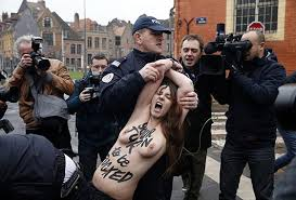 Topless protester at DSK trial 4